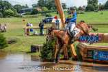 Tina Cook and Billy the Red jump into the 4* water. Sadly a peck on landing at the last caused Tina to hit the deck otherwise it would have been a high placing for them
