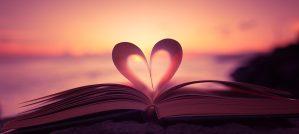 Heart shape paper book on the beach