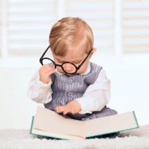 Boy toddler reading a book