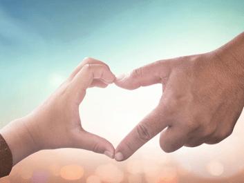 Fingers making heart shape