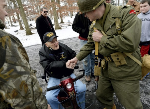 A re-enactor shakes hands with James Franklin Bowman, a World War II veteran from Lykens, during Saturday's Battle of the Bulge re-enactment at Fort Indiantown Gap. Bowman served with the 99th Combat Infantry and was wounded during the actual Battle of the Bulge. (Jeremy Long — Lebanon Daily News)