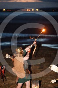 Roman archer firing a burning arrow