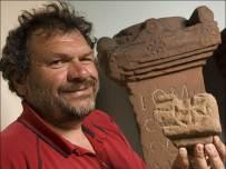 Tony Wilmott holding the altar fragment. Pic Hadrian's Wall Heritage