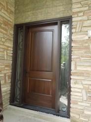 Wood door with vinyl frame