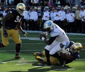 North Carolina quarterback Marquise Williams is tackled at the 3-yard line by Notre Dame defensive lineman Issac Rochell but ends up in the end zone as Notre Dame's Jarron Jones, left, pursues in the first half of an NCAA college football game, Saturday, Oct. 11, 2014, in South Bend, Ind. (Joe Raymond, AP)