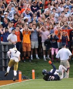Virginia fans react as Notre Dame's Will Fuller (7) scores on a touchdown pass with UVA's Maurica Canady (26) falling after attempting to stop the play during an NCAA college football game in Charlottesville, Va., Saturday, Sept. 12, 2015. (P. Kevin Morley/AP)