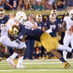 Longhorns quarterback Tyrone Swoopes (18) is tackled by Notre Dame Fighting Irish linebacker Jaylon Smith (9) in the second quarter. Credit: Matt Cashore-USA TODAY Sports