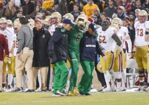 Senior cornerback KeiVarae Russell is helped off the field during Notre Dame's 19-16 victory over Boston College on Saturday. Russell was diagnosed with a broken tibia and is out for six to eight weeks. (Photo by Caroline Genco / The Observer)