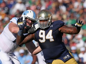 SOUTH BEND, IN - OCTOBER 11: Jarron Jones #94 of the Notre Dame Fighting Irish rushes against Jon Heck #71 of the North Carolina Tar Heels at Notre Dame Stadium on October 11, 2014 in South Bend, Indiana. (Photo by Jonathan Daniel/Getty Images)