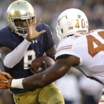 Notre Dame quarterback Malik Zaire, left, runs with the ball against Texas defensive end Naashon Hughes during the first half of an NCAA college football game Sept. 5, 2015, in South Bend, Ind. (AP Photo/Nam Y. Huh)