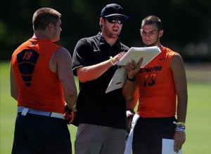Tight end Henry Mondeaux (19) and quarterback Will Grier (13) listen as coach Jordan Palmer during the Nike 7on7 elimination play at Nike World Headquarters. Credit: Steve Dykes / USA TODAY Sports