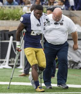 Notre Dame's Shaun Crawford (20) leaves the field with an injury during the Notre Dame - Nevada game. (Robert Franklin, South Bend Tribune.)