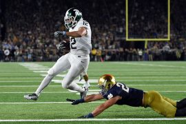 R.J. Shelton #12 of the Michigan State Spartans scores a touchdown in front of Drue Tranquill #23 of the Notre Dame Fighting Irish during the first half of a game at Notre Dame Stadium on September 17, 2016 in South Bend, Indiana. Credit: Stacy Revere/Getty Images