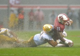 Notre Dame's James Onwualu tackles NC State's Matthew Dayes. (Grant Halverson / Getty Images)