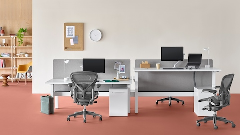 ergonomic chair là gì ucomfort massage herman miller modern furniture for the office and home nevi link standing desk system with rectangular work surfaces one of four desks at