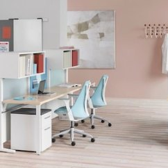 Ergonomic Chair Là Gì Wingback Chairs Leather Herman Miller Modern Furniture For The Office And Home An Open Healthcare Administrative Area Featuring Light Blue Sayl Gray Mirra 2