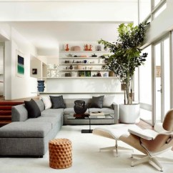 White Leather Chairs For Living Room Swivel Chair And Sofa Eames Lounge Ottoman Herman Miller Three Quarter Rear View Of A In