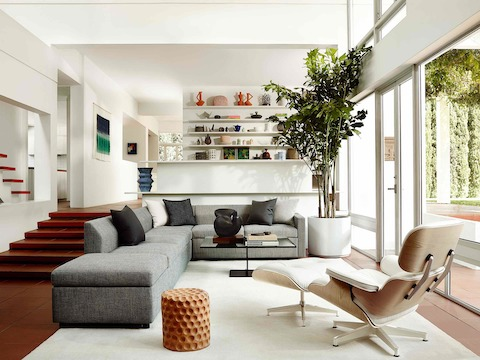 living room chair and ottoman covers chicago eames lounge herman miller three quarter rear view of a white leather in