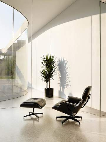 black eames chair bedroom wooden lounge and ottoman herman miller angled view of a leather with shell