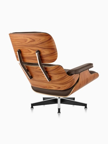 wood and leather chair dining cushion covers ikea eames lounge ottoman herman miller three quarter rear view of a brown with veneer