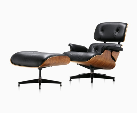 wood and leather chair grey weave garden chairs eames lounge ottoman herman miller black with a veneer shell viewed from