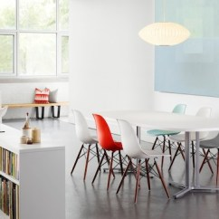 Plastic Chairs With Stainless Steel Legs High Folding Chair Eames Molded Side Herman Miller Open Meeting Area Featuring Red White Gray And Blue