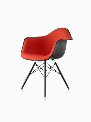eames bucket chair hanging malaysia molded plastic side herman miller red upholstered armchair with dowel legs viewed from a 45 degree