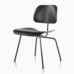 Black Eames Chair Baby 3 Months Molded Plywood Side Herman Miller With Steel Legs Viewed From A 45 Degree Angle