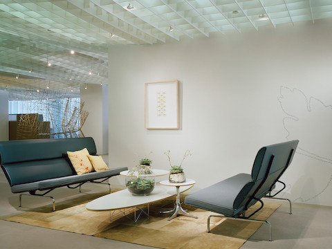 eames sofa compact bed suppliers glasgow area lounge seating herman miller two gray compacts facing each other in an office lobby