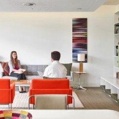 Living Room Office Home Decor Grey Walls Herman Miller In This Quiet Enclosed Haven Setting A Woman Sits On Tuxedo Sofa