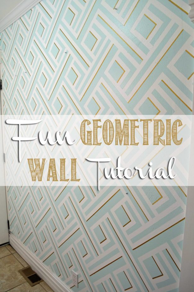 Fun Geometric Wall Tutorial on hertoolbelt.com  Seriously this design was made with paint and Frog Tape, so easy.