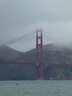 Golden Gate Bridge in fog in San Francisco by hesaidorshesaid