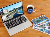 laptop coffee travel brochures