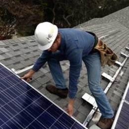 HE Solar LLC co-owner Eric Hoffman installing solar