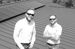 Eric and Derrick Hoffman next to solar panels