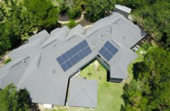 solar panel cost displayed on a composition shingle roof 20 miles East of Austin TX