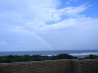 A rainbow over the ocean after a thunderstorm, as seen from our balcony