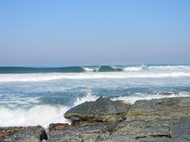 Waves breaking behind the rocky ridge - Ifafa beach