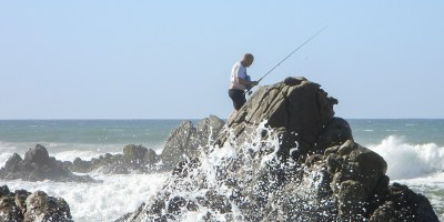 Enjoying the thrill of the breaking waves at high tide. Fishing rocks!