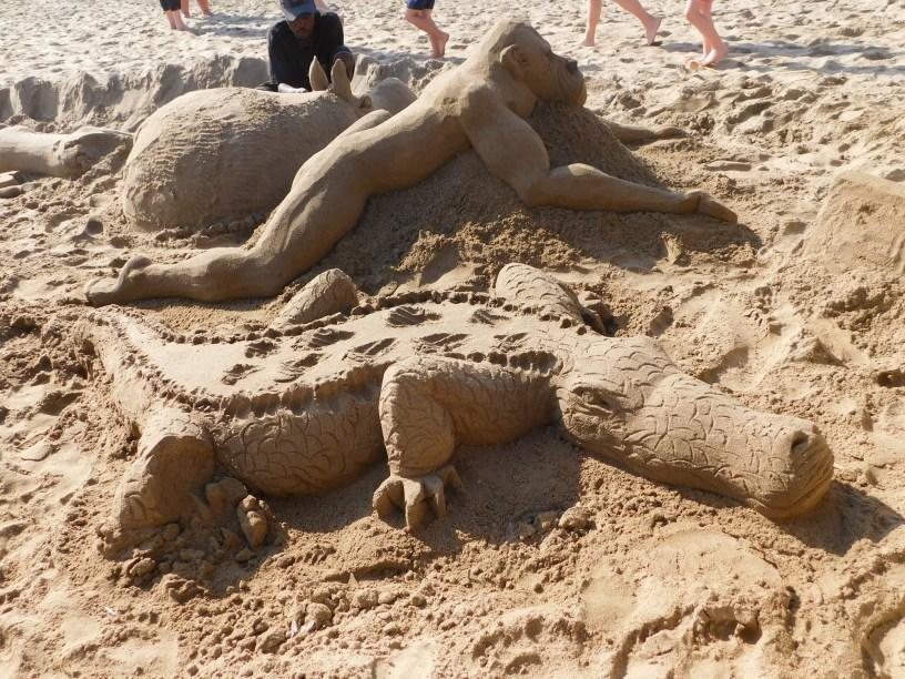 Crocodile, big ape and hippopotamus sand art on St Michaels on Sea Beach in KwaZulu-Natal