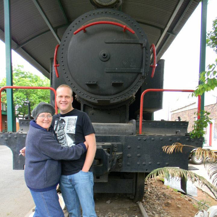 My son and I in front of the old steam locomotive at Oudewerf, Meyerton in 2011.