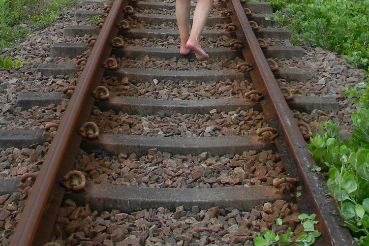 Barefoot on the railway lines