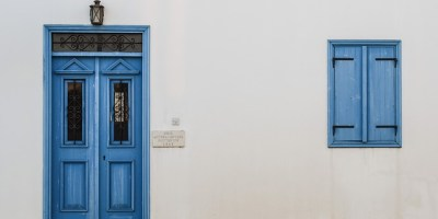 White walls with blue door and windowframe