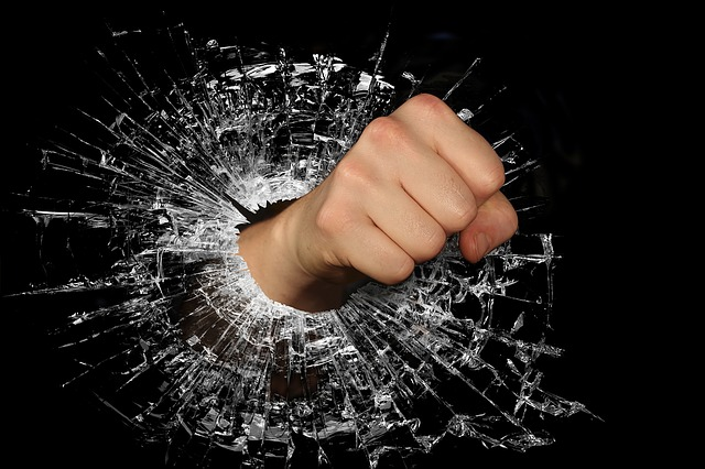 Breaking glass with a fist