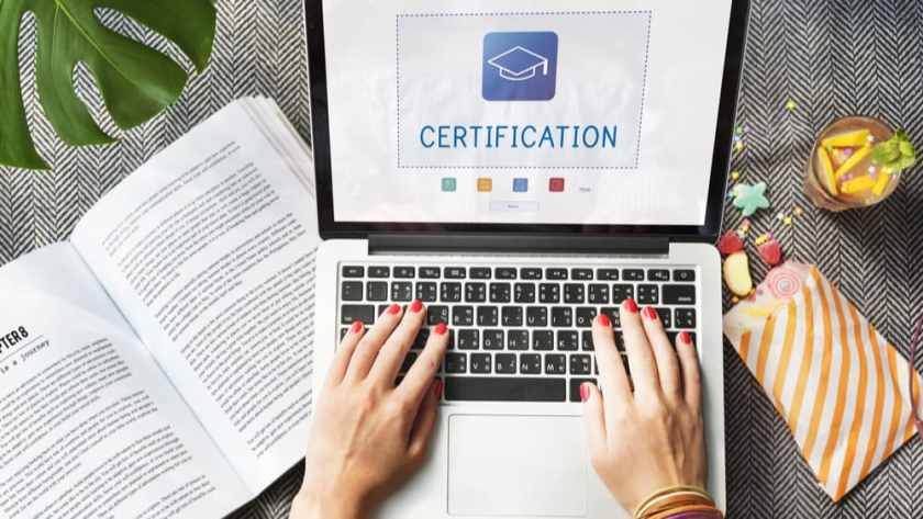 Manual vs. automated certification workflow process on laptop