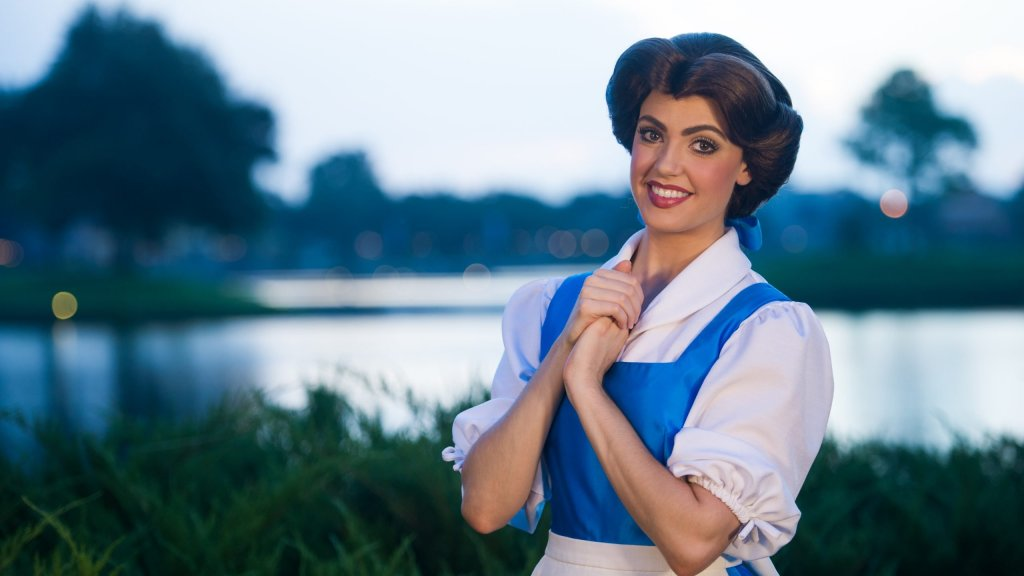 Disney Princess Belle in her blue outfit smiling big.