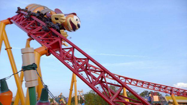 slink dog coaster cresting over a turning hill