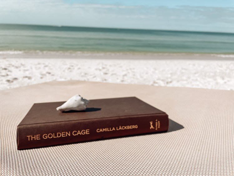 the golden cage review beach reading thriller