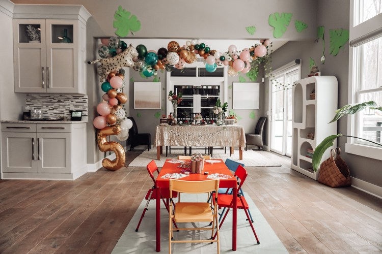 birthday party theme for girls inside, jungle, pink and green balloon garland, dorian grey sherwin williams