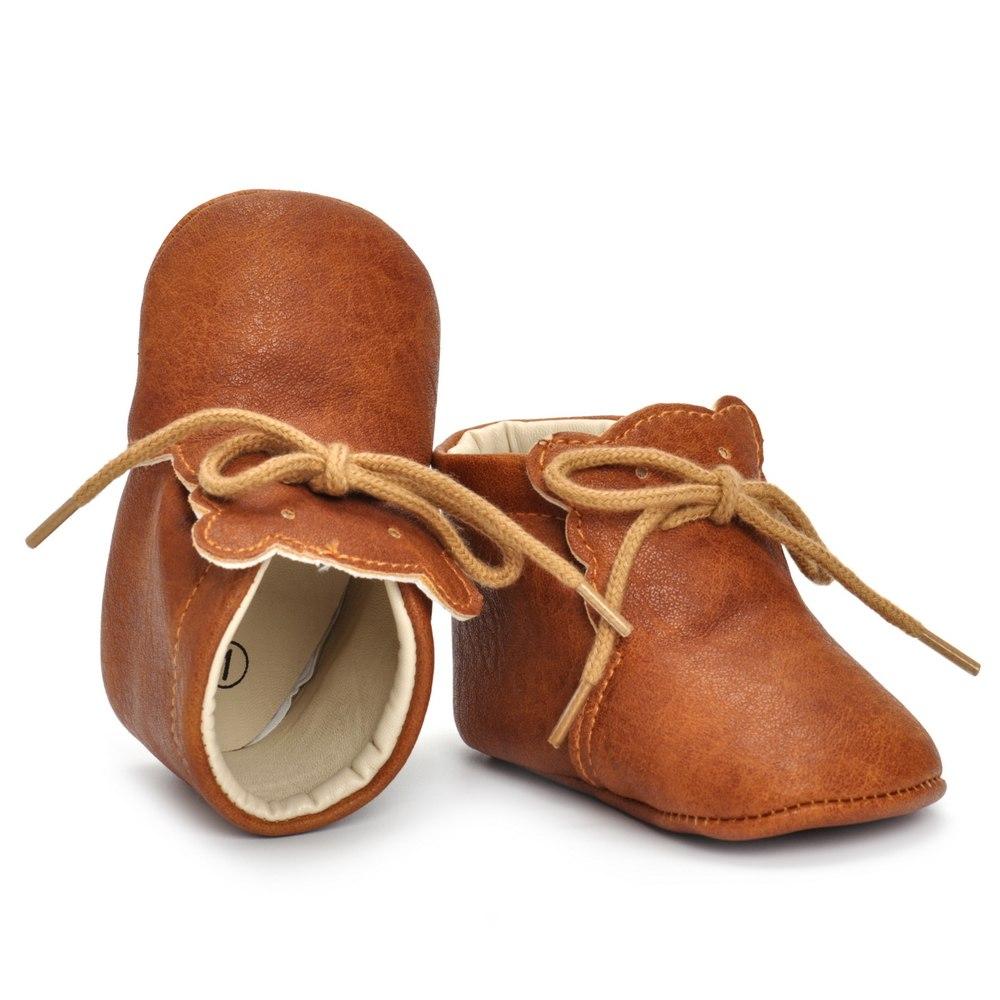 Paire de chaussures bébé marrons en cuir
